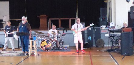 The Moon Howler Band performs at the Coach Eby Center for June 2015 Art Walk in Downtown Coldwater